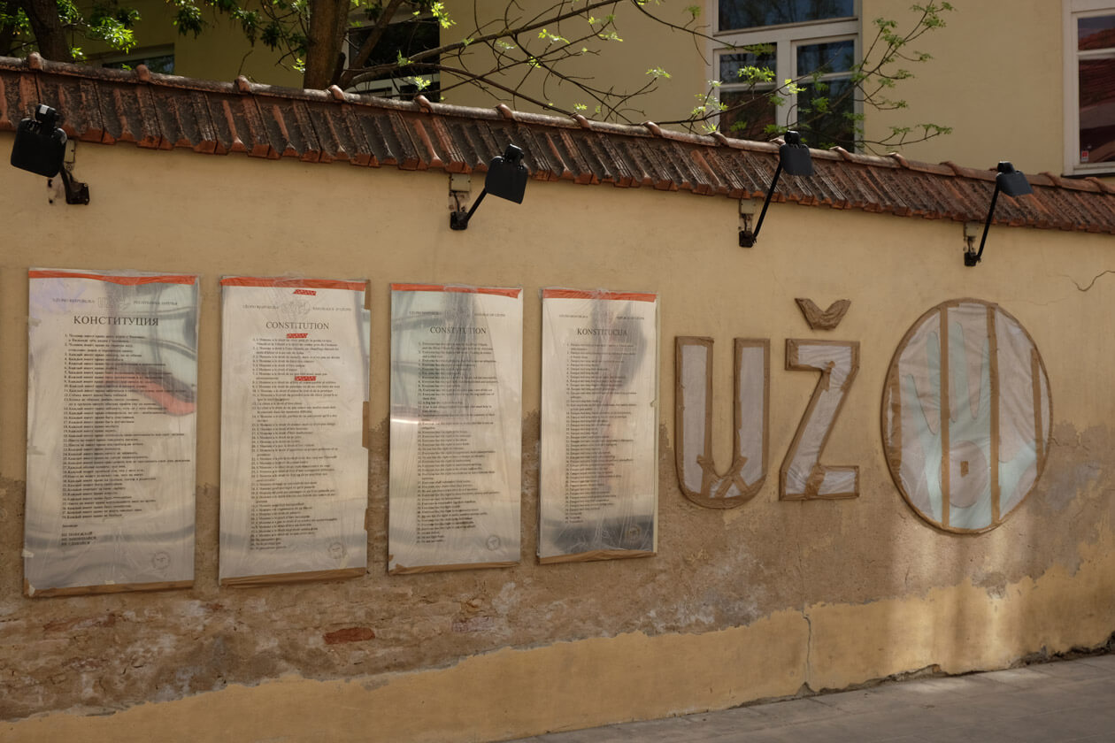 Uzupis's constitution is displayed on this wall in multiple languages