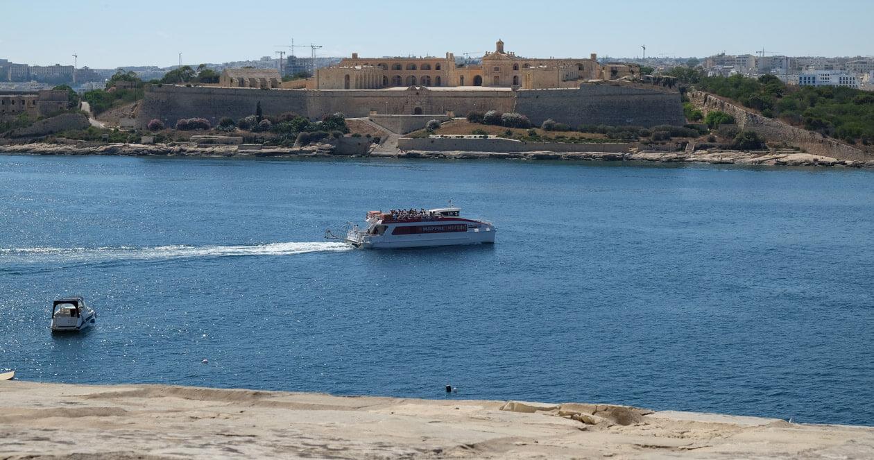 The Sliema ferry passing Fort Manoel