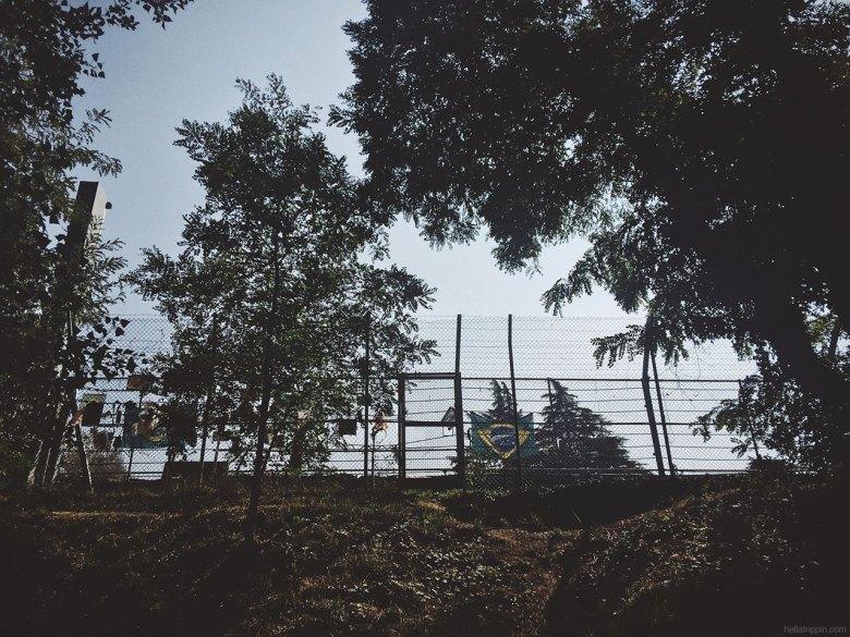 The unofficial Senna memorial at Tamburello corner, as seen from the riverbank.