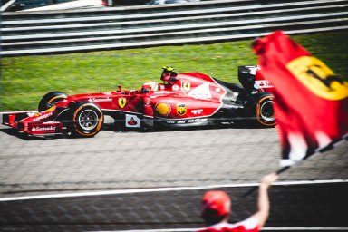 Ferrari driver Kimi Räikkönen navigates Turn 1 during Friday afternoon's practice session at the 2014 Italian Grand Prix at Monza.