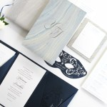 ocean inspired folio with silver foil and laser cut mask