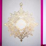 laser cut and gold monogram invitation design for luxury wedding