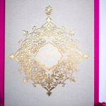 laser cut and gold monogram invitation design for luxury wedding
