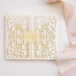 ivory and blush and gold invitation with laser cut and foil stamping