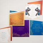 printed purple silk envelope with enclosures and laser cut folio | AZURE