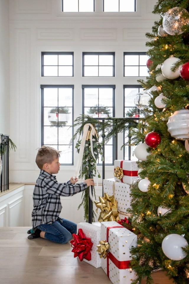 kid decorating for christmas