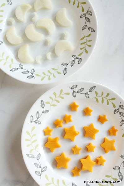 Moons and stars cut from fruit for Ramadan recipe by Hello Holy Days!