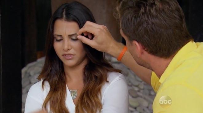 Bachelor Juan Pablo pulls Andi's eyebrow.