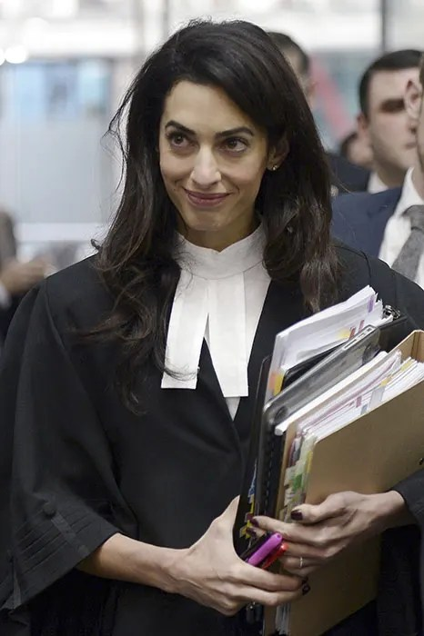 Amal Clooney robes up as she starts work on new court case in France