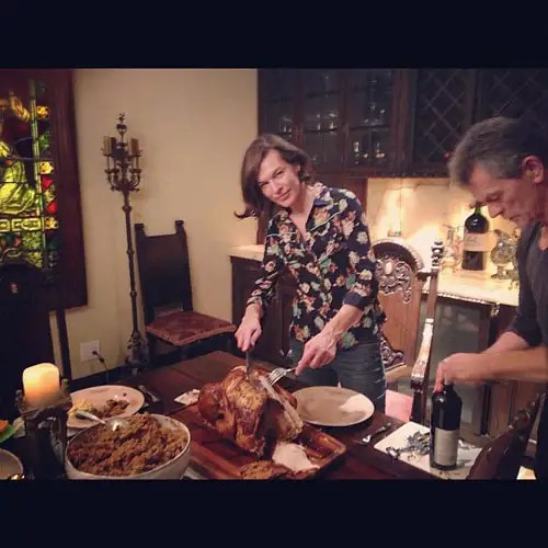 Milla Jovovich Prepares Thanksgiving Dinner With Family