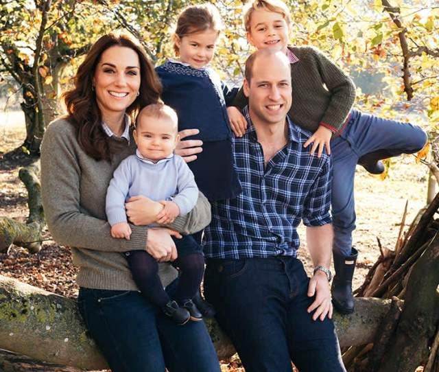 Royal Family Album See Prince Williams Cutest Dad Moments With George Charlotte And Louis