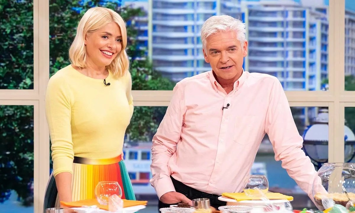 Holly Willoughby and Phillip Schofield take their families on special night during joint holiday