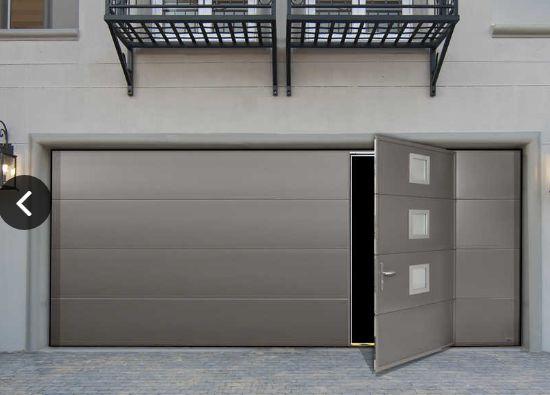 Porte De Garage Sectionnelle Maori Motorisee Ouverture Plafond En Acier Avec Portillon Et Hublot Isolation Thermique