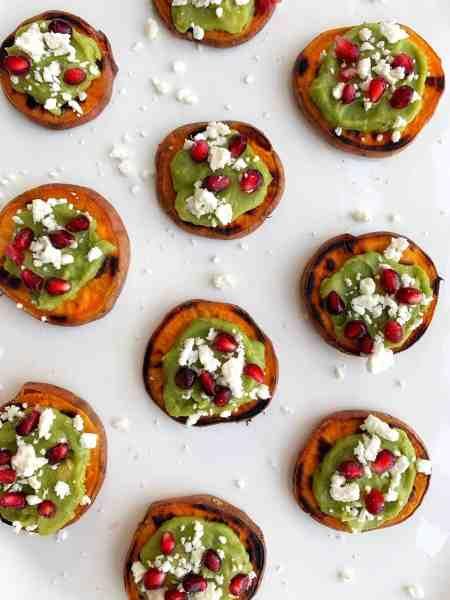 Sweet potato bites with avocado, feta and pomegranate seeds