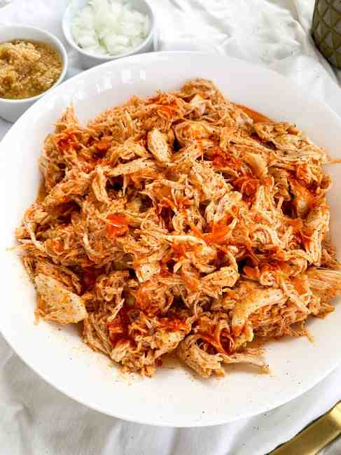 Healthy 5 Ingredient Slow Cooker Buffalo Chicken that is Paleo, Keto, Gluten Free, and Dairy Free.