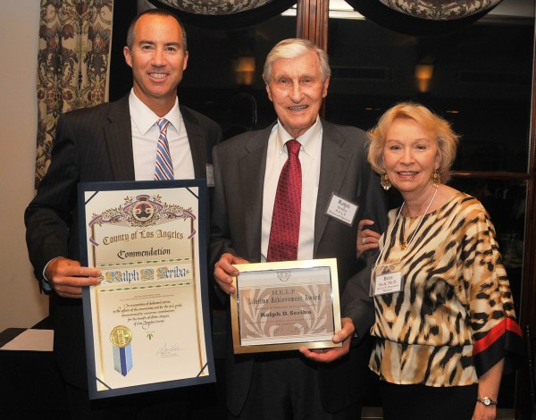 Steve Napolitano, Senior Deputy to L.A. County Supervisor Don knabe, left, and Drl Britt Huff, H.E.L.P. Executive Director, present a Lifetime Achievement Award to Ralph Scriba