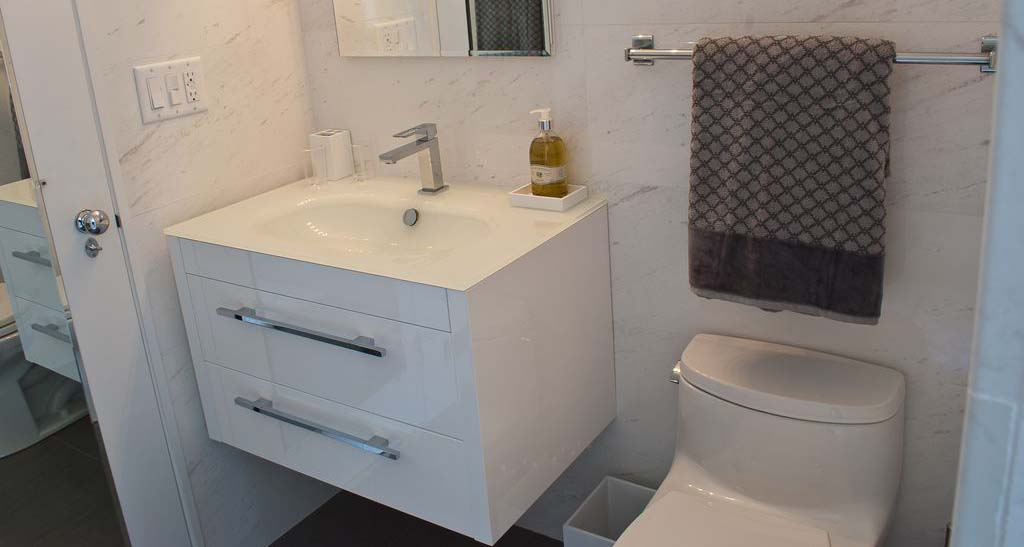 Floating vanity in a small bathroom. Good choice.