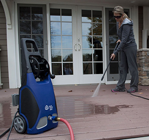 Pressure washing the patio.