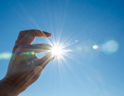 Picture of sun through fingers