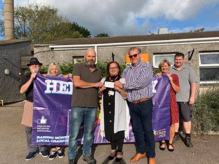 festival organiser Paul Turton and Blue Anchor landlord Simon Stone presented a cheque to Trengrouse manager Melanie Bedlow.