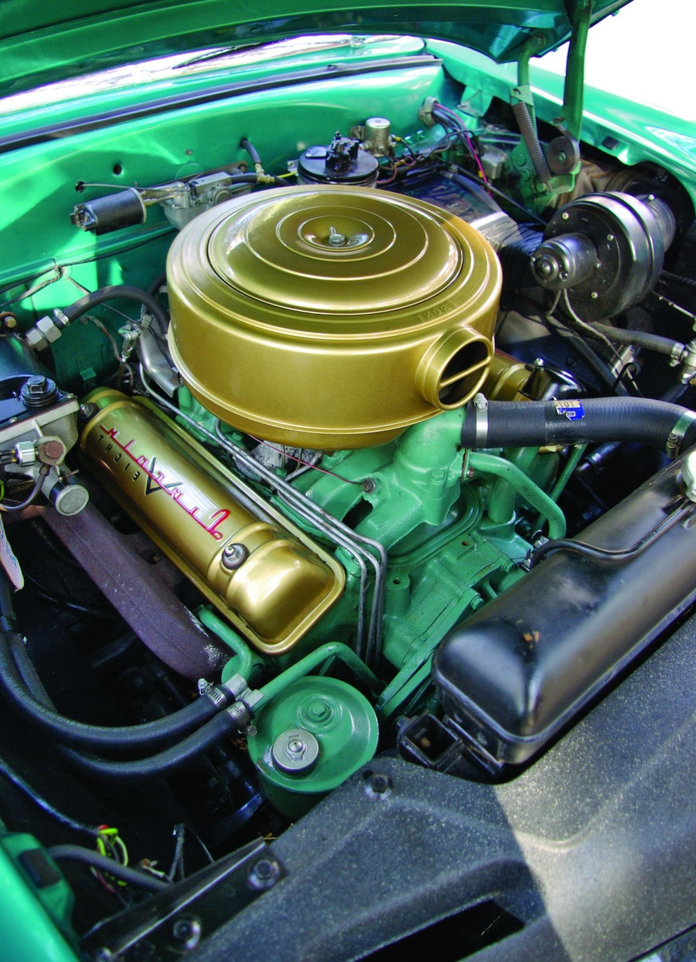 hight resolution of the gold finish on the valve covers and air cleaner complements the green painted engine block even after 61 000 miles the untouched 341 cu in v 8 engine