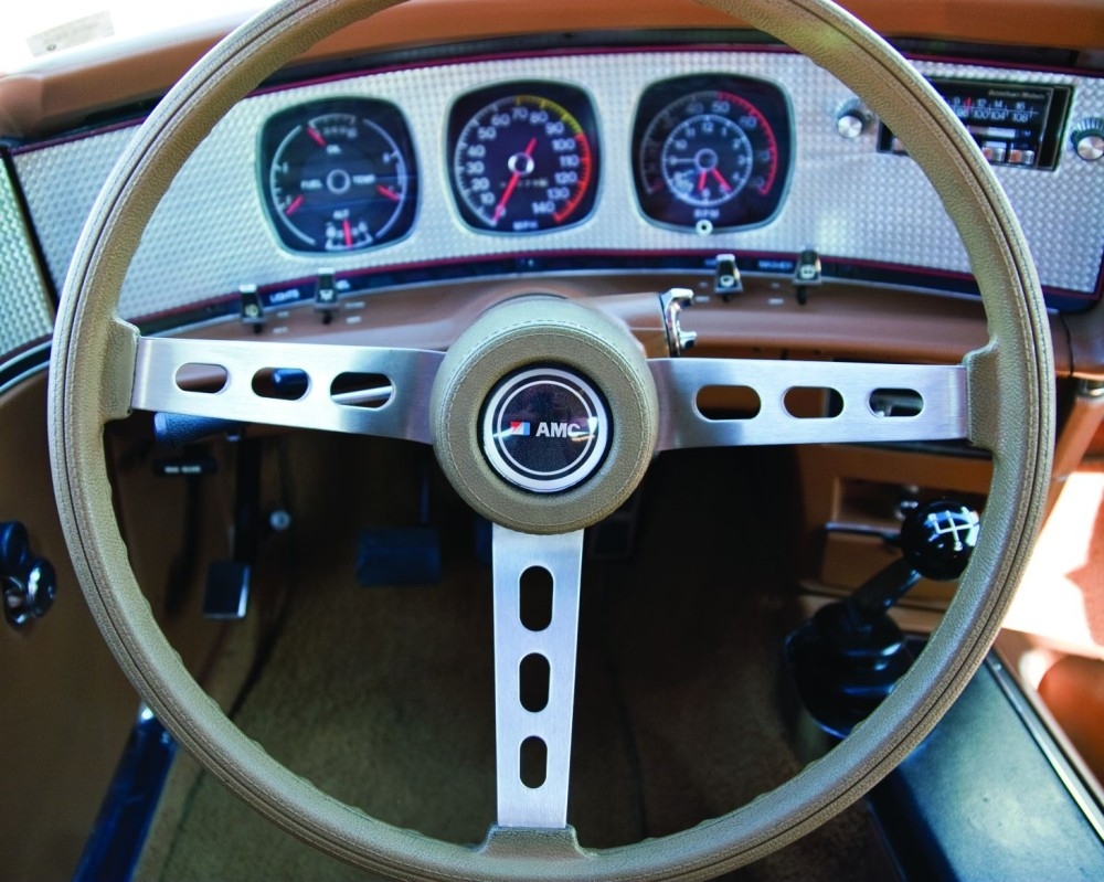 medium resolution of bucket seats were standard issue on the 1971 74 javelin but the machine turned dash and door overlays were amx specific racy rally pac instruments added