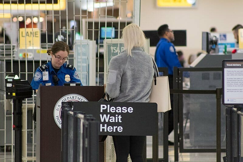 woman standing at the airport security