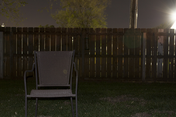 "ISO - 200 f/7 25 seconds For this photo I kept the same settings as the previous one, except I used the flash. By popping off the flash I was able to quickly expose the chair and backyard while still ""burning in"" the background elements. You can use this method for people if your shutter speed is not to slow and your subject can stand very still."