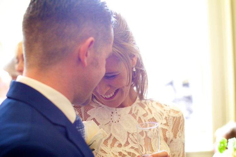 Newly weds in love by professional Wedding Photographer Henry Wells