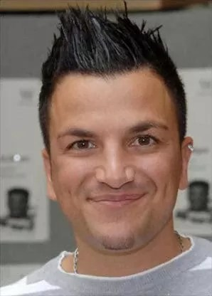 Peter Andre spiky hair with white streaks.