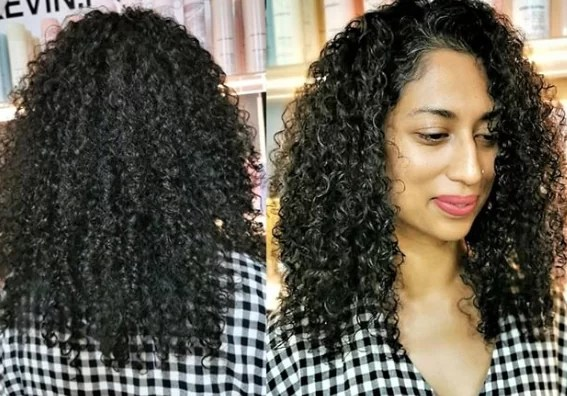 Curls with layers and side bangs
