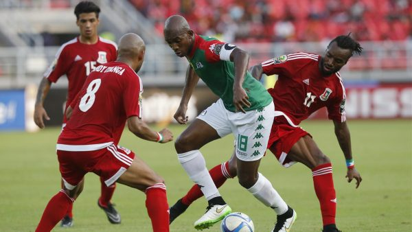Burkina Faso's Charles Kabore (C) fights for the ball with Equatorial Guinea's Randy (8) and Javier Balboa (11) during their Group A soccer match