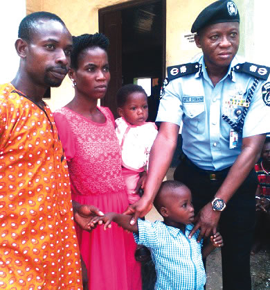 abia-cp-adeleye-oyebade-handing-over-rescued-boy-to-his-mother