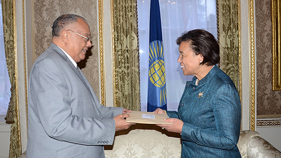 The Gambian Ambassador Francis Blain presents Secretary-General Patricia Scotland with his country's formal application to rejoin the Commonwealth.