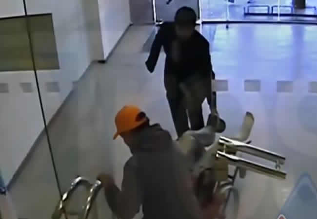 wheelchair-bound-robber-and-his-gang-rob-bank-punch-newspapers