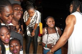 fans crying and screaming over Flavour at his concert