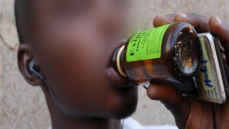 boy drinking codeine