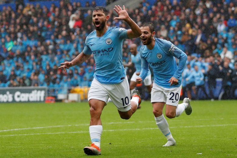 Aguero marks new deal with goal as City thrashes Cardiff