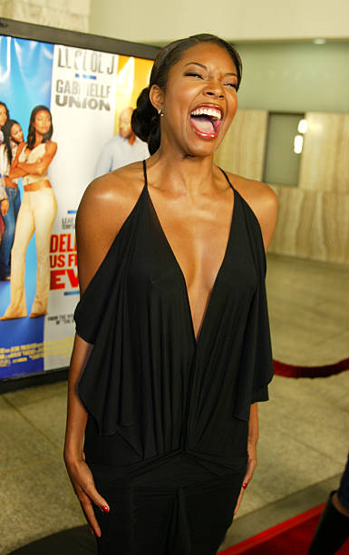 """HOLLYWOOD - JANUARY 29:  Actress Gabrielle Union arrives at the premiere of """"Deliver Us From Eva"""" at the Cinerama Dome and after-party at the Sunset Room on January 29, 2003 in Hollywood, California. (Photo by Kevin Winter/Getty Images)"""