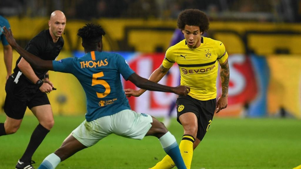 Borussia Dortmund Finishes Ahead of Atletico Madrid in Group A