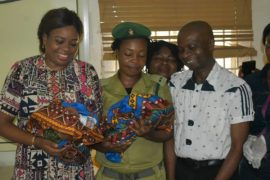 Cross River State Commissioner for Health, Dr Inyang Asibong and other staff of Afokang Prison, Calabar, holding the twins delivered by a female inmate of the Prison in Calabar
