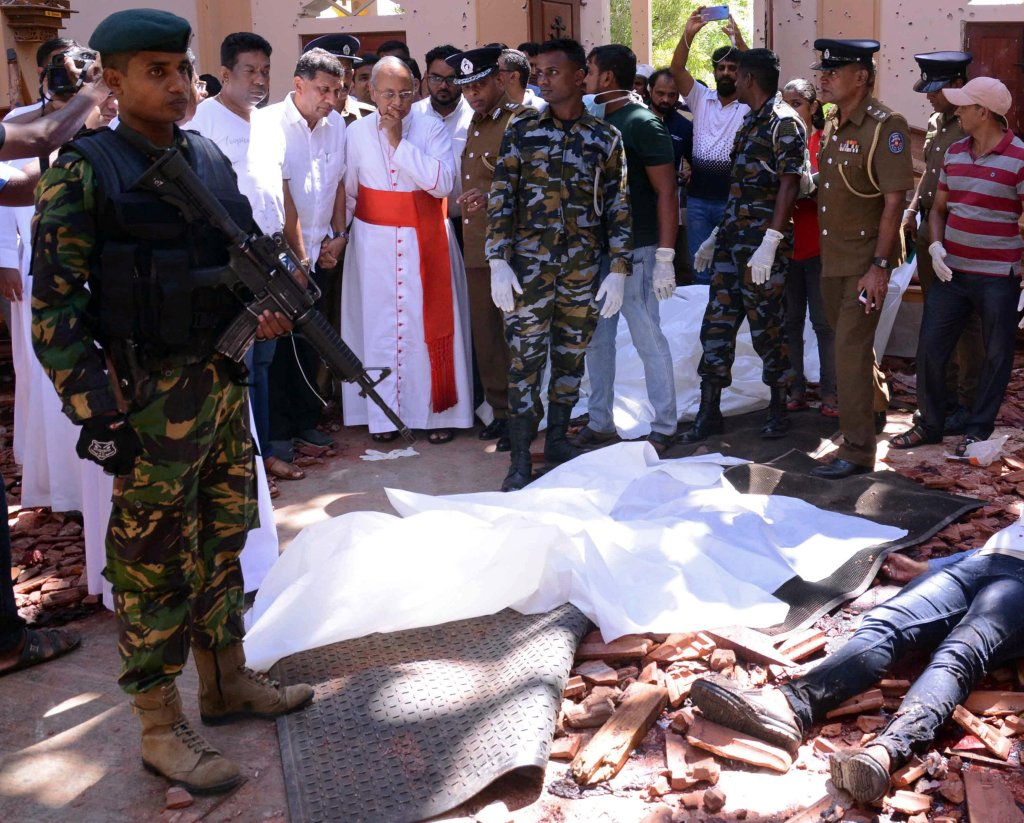 Cardinal Malcolm Ranjith of Colombo, Sri Lanka, looks at the explosion site inside a church in Negombo April 21, 2019, following a string of suicide bomb attacks on churches and luxury hotels across the island. (CNS photo/Reuters) See SRI-LANKA-EASTER-BOMBINGS, DINARDO-SRI-LANKA-ATTACKS, and EASTER-SEASON-ATTACKS April 23, 2019.