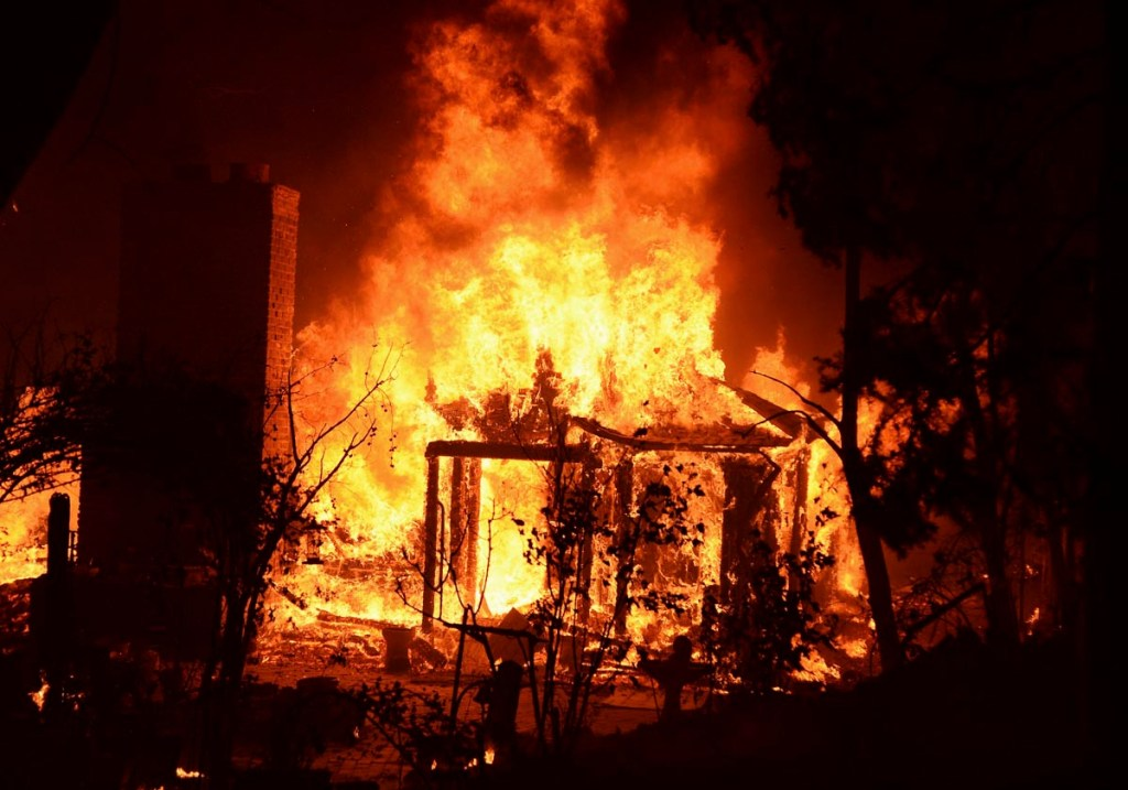 Fire engulfs a house as firefighters battle the Powerhouse wildfire at the Angeles National Forest, with the fire now having destroyed several homes near the Lake Hughes area in California June 1, 2013. The Powerhouse Fire remained at 15 percent containment after ravaging over 5,600 acres of the forest by Saturday evening.   REUTERS/Gene Blevins  (UNITED STATES - Tags: DISASTER ENVIRONMENT) ORG XMIT: GRB042