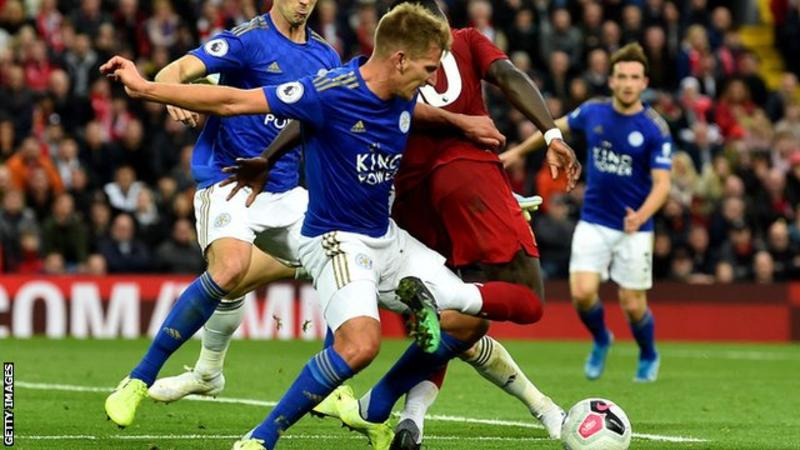 Last minute penalty keeps Liverpool firmly on top