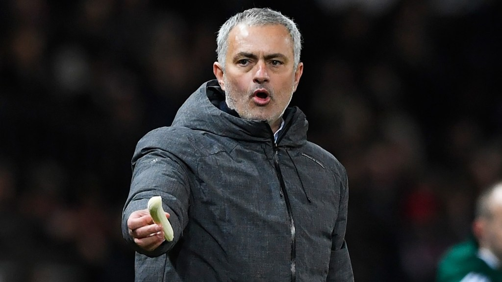 MANCHESTER, ENGLAND - MARCH 16:  Jose Mourinho, Manager of Manchester United attempts to get a a banana to Marcos Rojo of Manchester United during the UEFA Europa League Round of 16, second leg match between Manchester United and FK Rostov at Old Trafford on March 16, 2017 in Manchester, United Kingdom.  (Photo by Stu Forster/Getty Images)