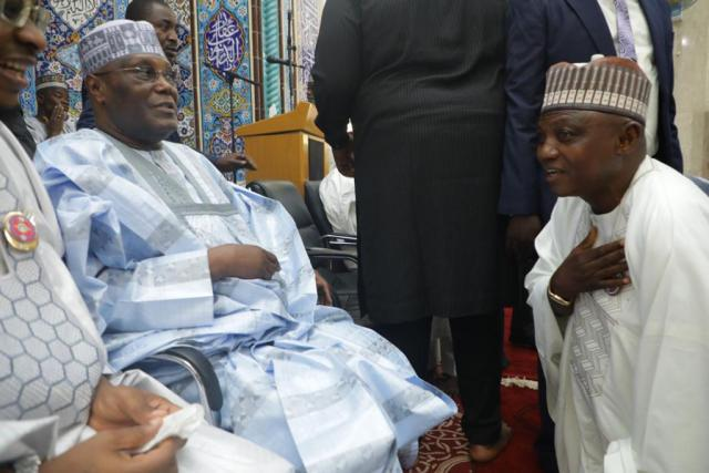 Buhari's Media Aide, Garba Shehu Kneels Before Atiku