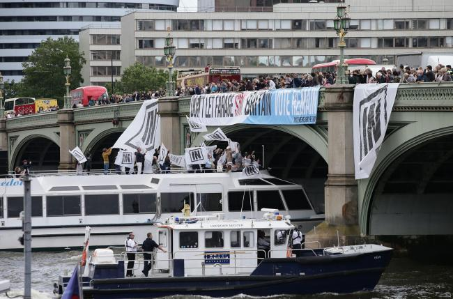 A boat carrying Bob Geldof takes part in a pro-EU counter demonstration, as a Fishing for Leave pro-Brexit