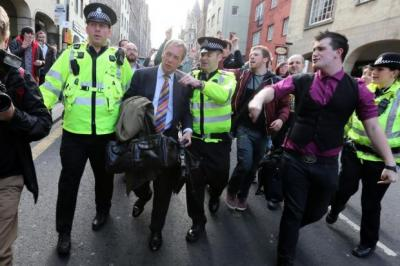 Top: Ukip leader Nigel Farage had to be escorted away by police after he was faced by an angry crowd on a trip to Edinburgh last year.Above: Misty Thackeray