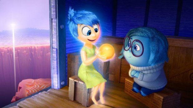 Joy and Sadness with a happy memory. (Image: Pixar)