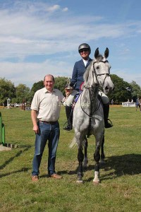 Winner 1.30m Open - Sarah Hedges riding Crystal Clear VII receiving the NFU Challenge Trophy presented by Matthew Price of NFU Ross on Wye.
